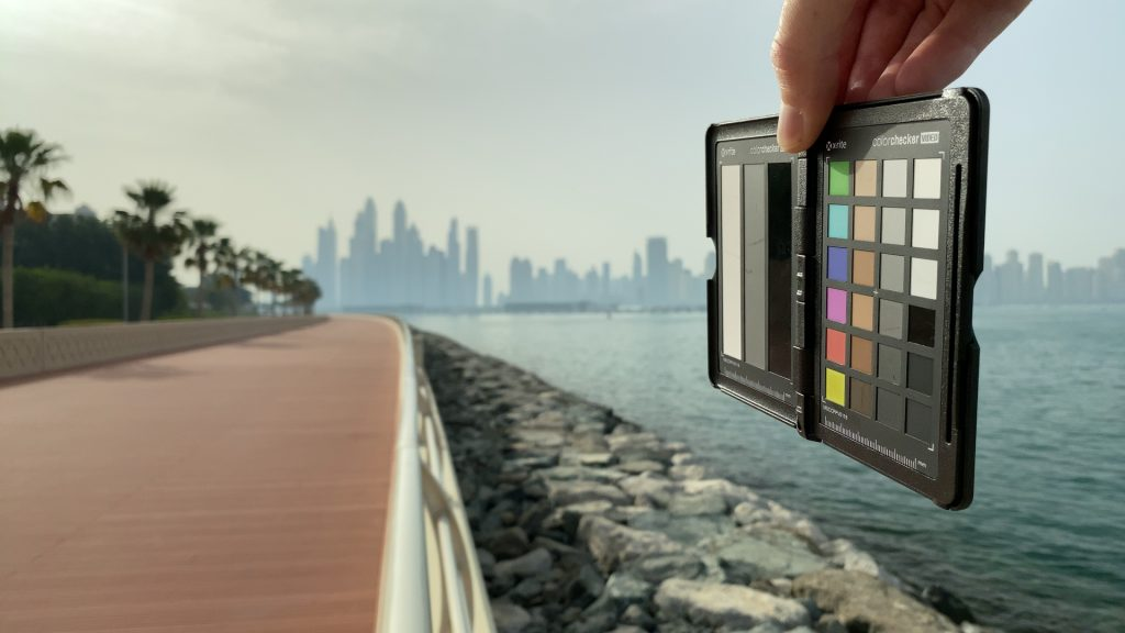 A video frame of the X-Rite ColorChecker chart outdoors under daylight captured with the Beastgrip Pro Series VND filter at step 1 of 13.