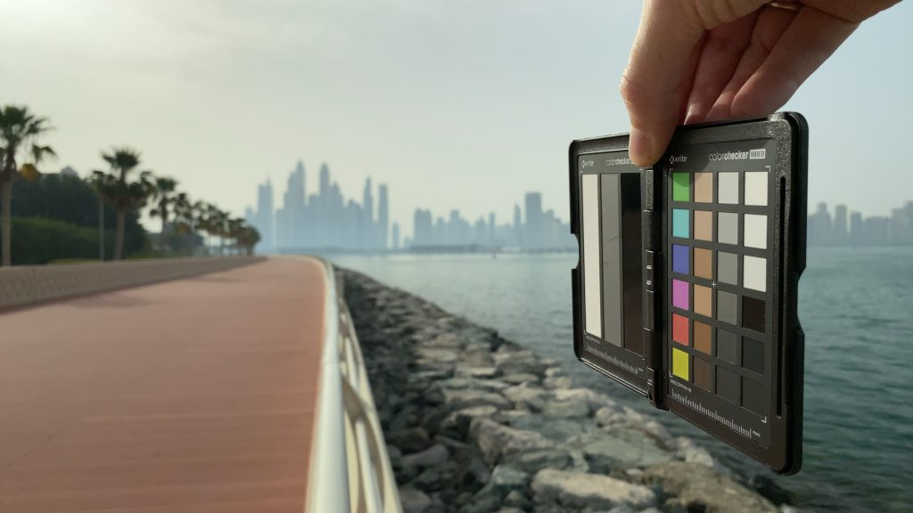 A video frame of the X-Rite ColorChecker chart outdoors under daylight captured with the Beastgrip Pro Series VND filter at step 2 of 13.