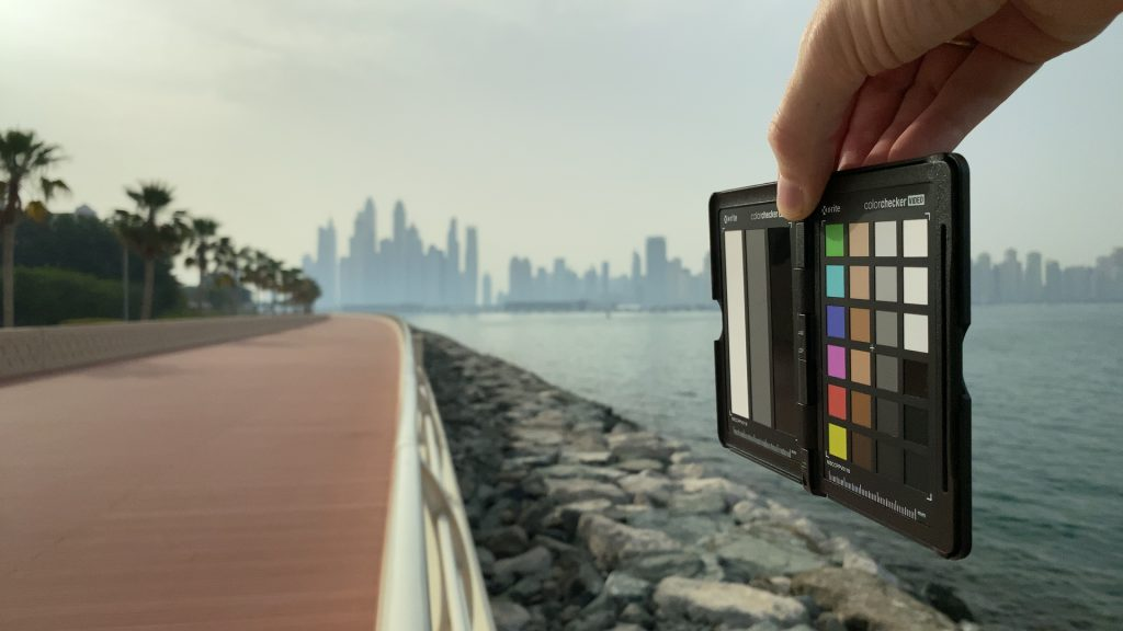 A video frame of the X-Rite ColorChecker chart outdoors under daylight captured with the Beastgrip Pro Series VND filter at step 6 of 13.