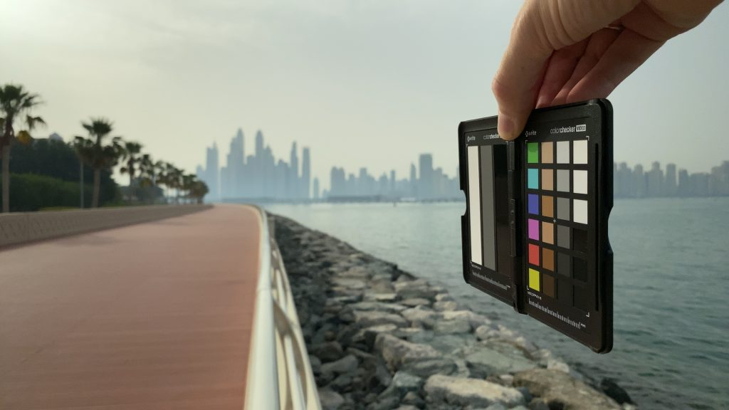 A video frame of the X-Rite ColorChecker chart outdoors under daylight captured with the Beastgrip Pro Series VND filter at step 8 of 13.