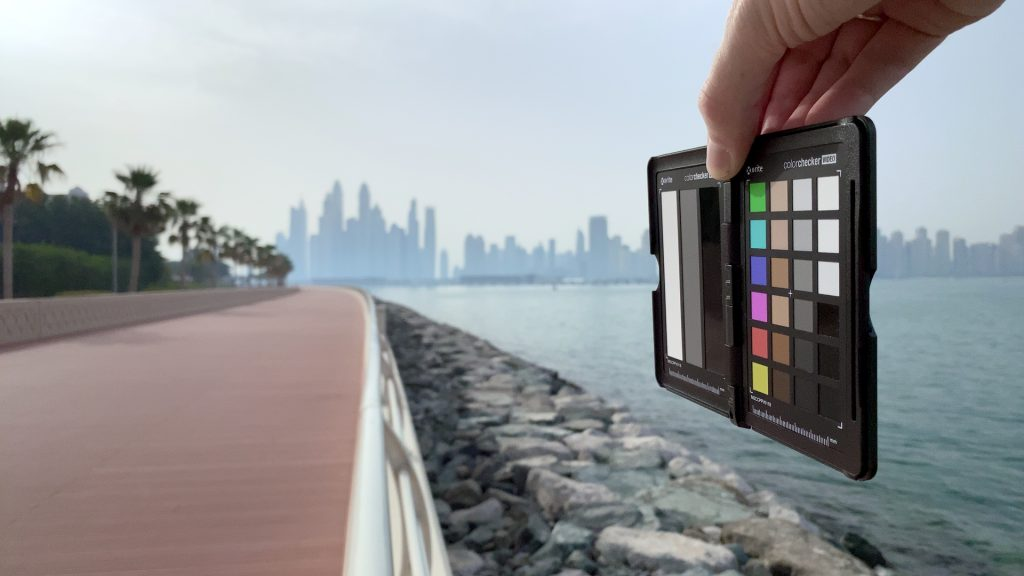 A color corrected video frame of the X-Rite ColorChecker chart outdoors under daylight captured with the Beastgrip Pro Series VND filter at step 7 of 13.