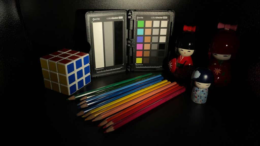 A video frame of the X-Rite ColorChecker chart indoors under tungsten light captured with the Beastgrip Pro Series VND filter at step 12 of 13.