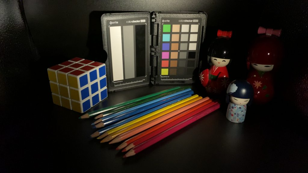 A video frame of the X-Rite ColorChecker chart indoors under tungsten light captured with the Beastgrip Pro Series VND filter at step 13 of 13.